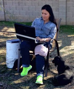 Diana at work in her back yard with her dogs, 2016.